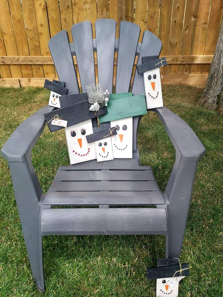 pallet-made chair and snowman wall art pieces