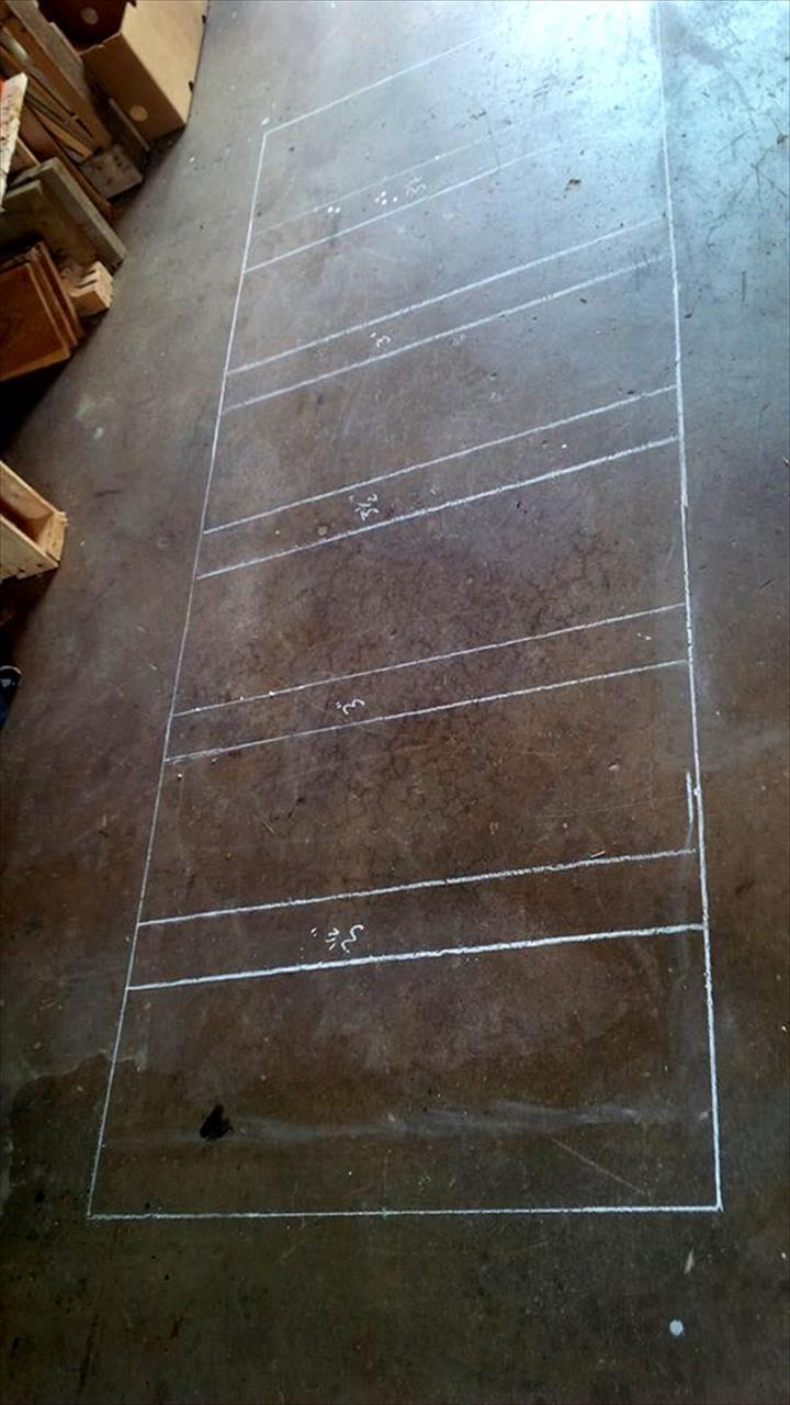 mark the measured dimensions of the headboard on floor using chalk