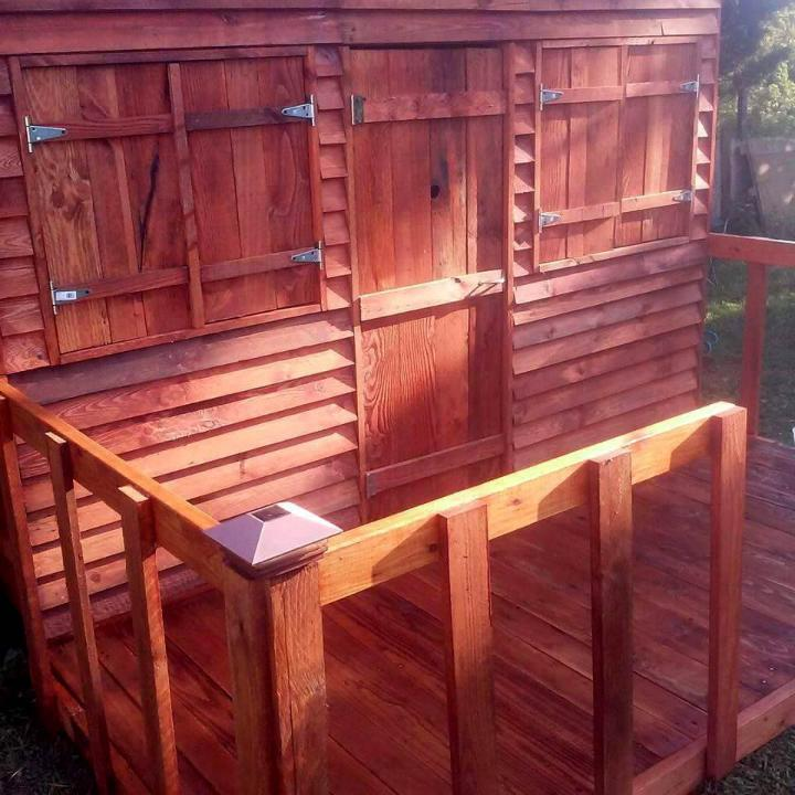 custom built and stained pallet playhouse