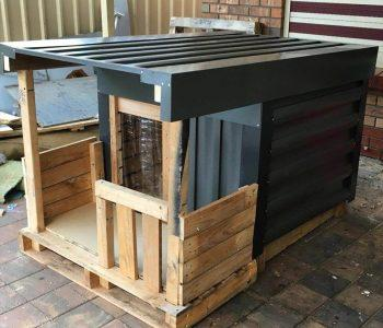 wooden pallet dog house with veranda