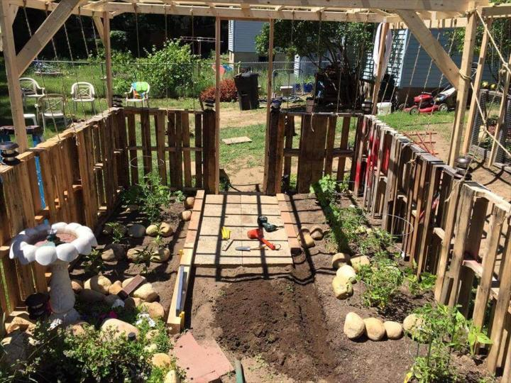 pallet garden with mini wooden fence all around