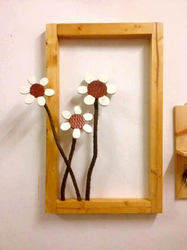 wooden pallet and faux flower wall art frame