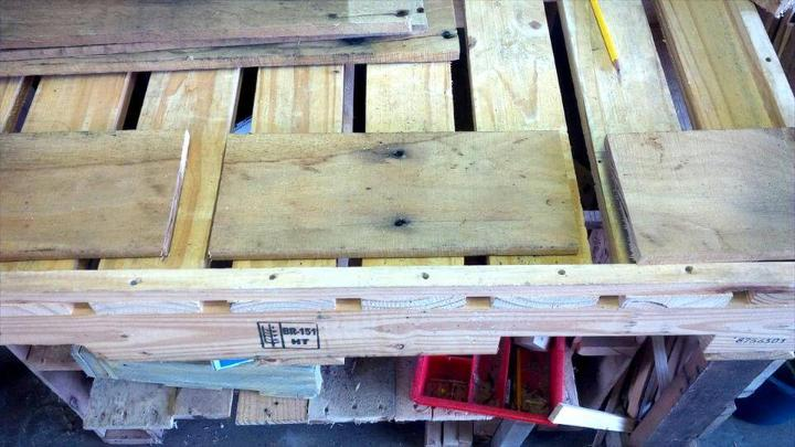 cutting and planning the wooden pallet boards for building drink caddy