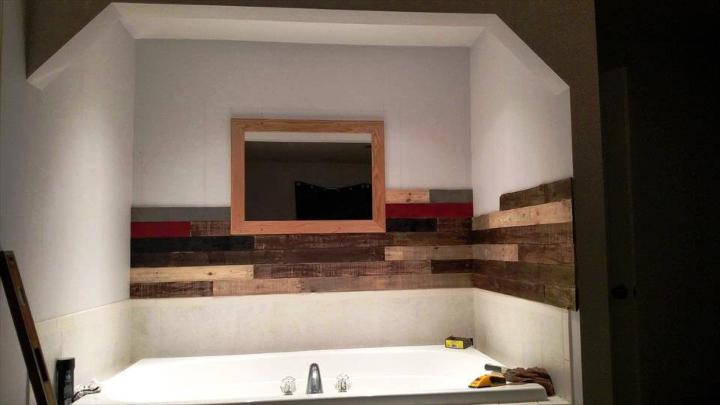 pallet wood wall installation around the jacuzzi bath tub