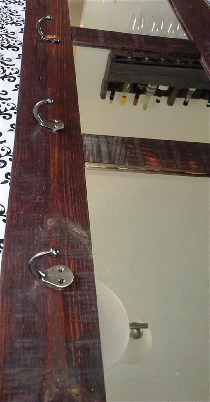 repurposed wooden pallet mirror with metal hooks