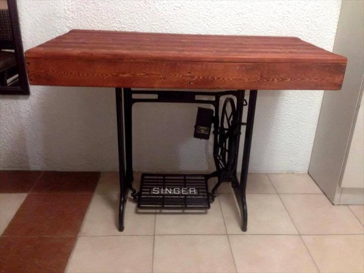 upcycled wooden pallet and old sewing machine base table