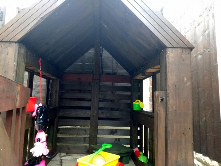 hand-built wooden pallet playhouse for little girl