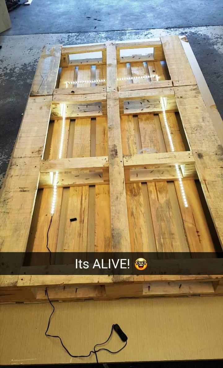 repurposed pallet and old wood into toddler bed