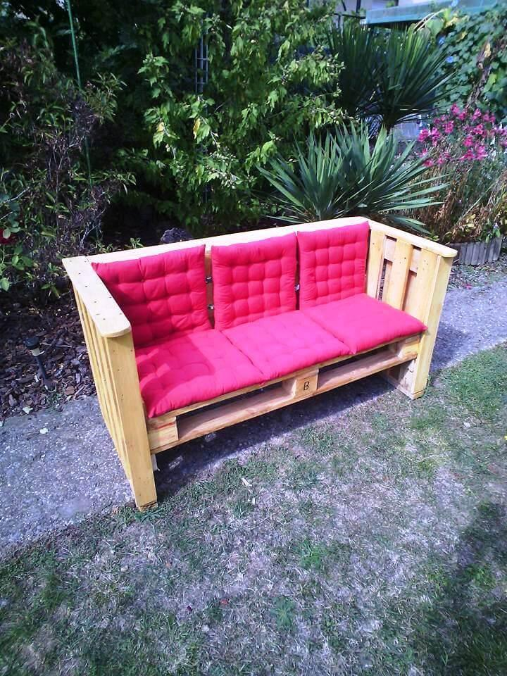 pink cushioned pallet outdoor bench or sofa