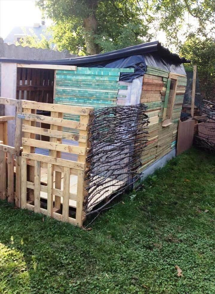 custom-built wooden pallet playhouse or shed