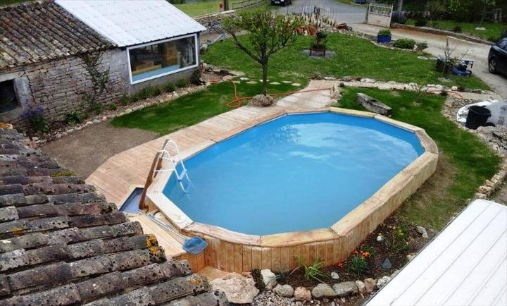 wooden pallets around the swimming pool