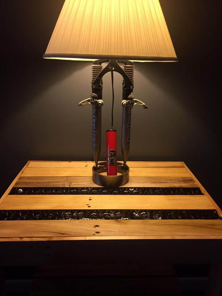 repurposed pallet and bicycled tire stand for bicycle lamp