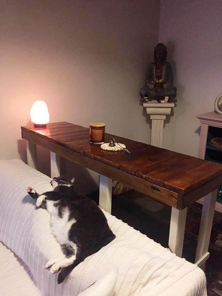 repurposed pallet wood behind sofa table