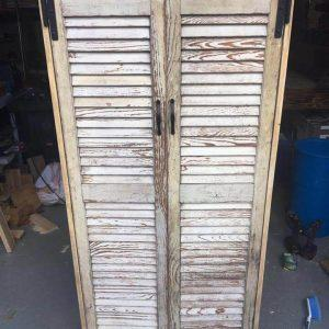 handcrafted pallet cabinet with old shutter doors