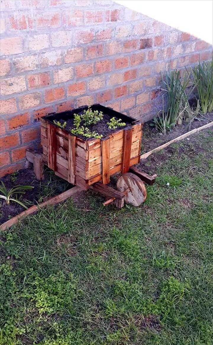 repurposed pallet wheelbarrow planter