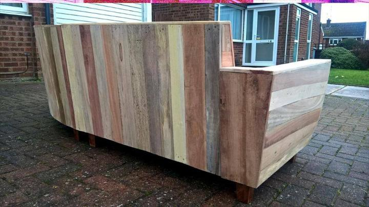 repurposed wooden pallet sofa with fancy curves